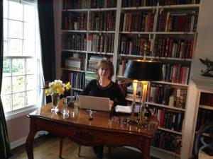 Carole at desk smiles